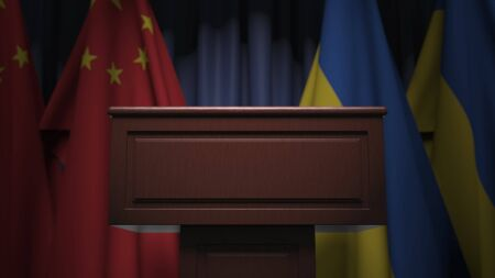 Flags of Ukraine and China at international meeting, 3D rendering