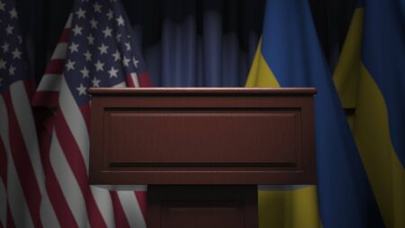 Flags of Ukraine and the USA at international meeting, 3D rendering