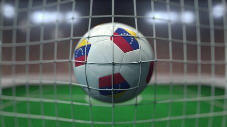Football with flags of Venezuela hits goal net. 3D rendering