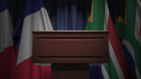 Row of flags of South Africa and France and and speaker tribune, conceptual 3D rendering Stockfoto