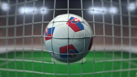 Football with flags of Slovakia hits goal net. 3D rendering