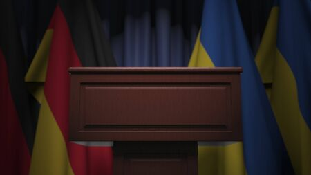 Flags of Ukraine and Germany at international meeting, 3D rendering