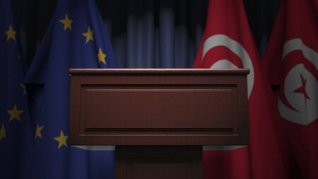 Many flags of Tunisia and the European Union EU, 3D rendering