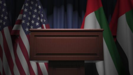 Flags of the UAE and the USA at international meeting, 3D rendering Banco de Imagens