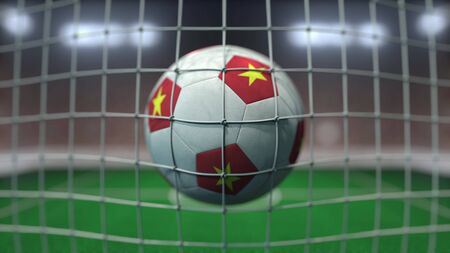 Football with flags of Vietnam hits goal net. 3D rendering