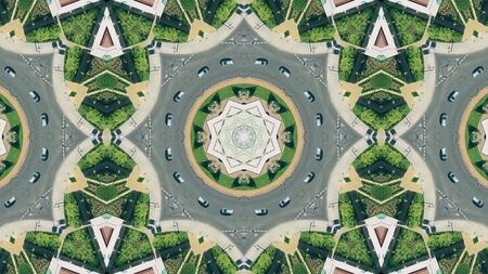 Kaleidoscopic effect aerial top view of a city roundabout traffic in Cordoba, Spain