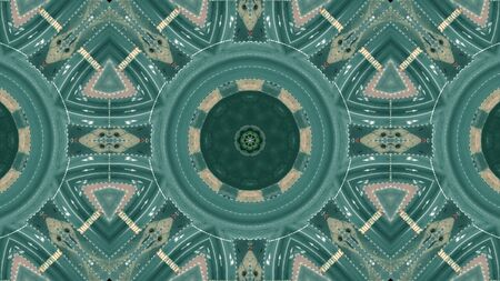 Kaleidoscopic effect aerial top shot of a city roundabout