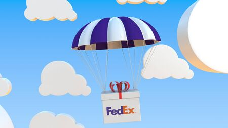 FEDEX logo on moving box moves under parachute. Editorial 3D rendering