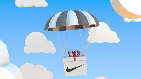 Carton with NIKE logo falls with a parachute. Editorial 3D rendering