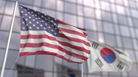 Waving flags of the United States and South Korea in front of a modern skyscraper. 3D rendering Фото со стока
