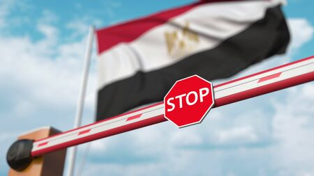 Closed boom barrier with stop sign against the Egyptian flag. Restricted entry or certain ban in Egypt. 3D rendering Foto de archivo