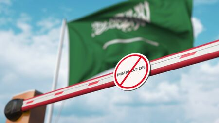 Closed boom gate with no immigration sign on the flag background. Border closure or immigration ban in Saudi Arabia. 3D rendering Foto de archivo