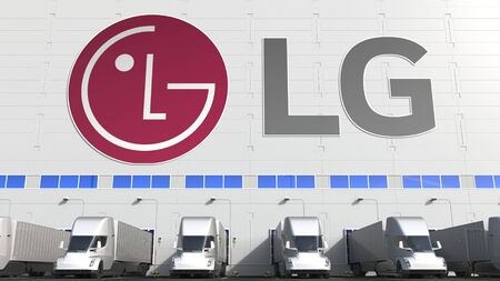 Electric semi-trailer trucks at warehouse loading bay with LG logo on the wall. Editorial 3D rendering Editorial