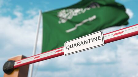 Closed boom gate with QUARANTINE sign on the Saudi Arabian flag background. Border closure or infection related isolation in Saudi Arabia Imagens
