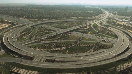 Aerial view of the big green highway interchange near the Arabian Ranches area in Dubai, UAE