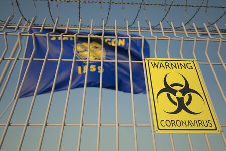Biohazard coronavirus sign on the barbed wire fence near flag of Oregon. COVID-19 quarantine related 3D rendering