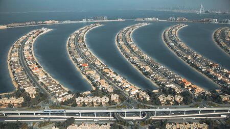 Aerial view of moving monorail train and fronds of the Palm Jumeirah island, United Arab Emirates Reklamní fotografie