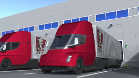 Electric trailer trucks with KFC logo being loaded or unloaded at warehouse. Logistics related 3D rendering Editorial