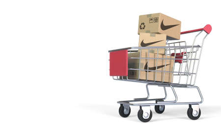 Cartons with NIKE logo in shopping trolley. Editorial 3D rendering Editorial