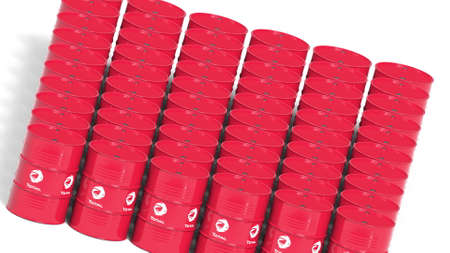 Rows of steel drums or industrial barrels with Total S.A. logo. Editorial 3D rendering