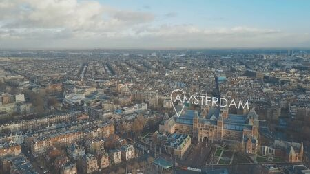 Aerial establishing shot of Amsterdam with city geotag, Netherlands Stock Photo