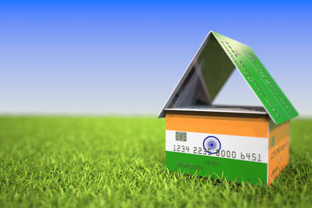 National flag of India on credit card house in the grass. Home loans related 3D rendering