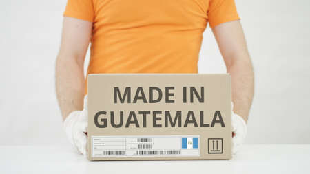 Parcel with MADE IN GUATEMALA text and warehouse worker