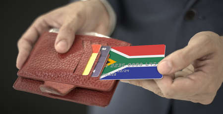 Man pulls plastic bank card with flag of South Africa out of his wallet, fictional card number