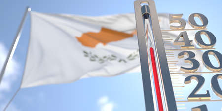 Thermometer shows high air temperature against blurred flag of Cyprus. Hot weather forecast related 3D rendering Imagens