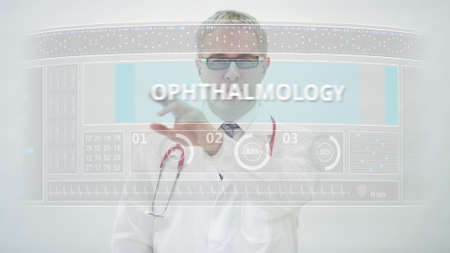 OPHTHALMOLOGY tab is scrolled by a doctor on a modern display