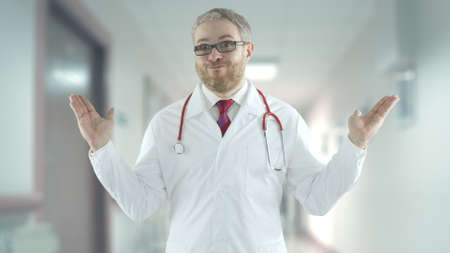 Unqualified doctor spreads his hands in a hospital hallway