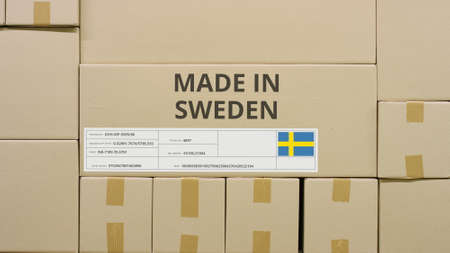 Carton with printed MADE IN SWEDEN text and flag. Warehouse logistics concept