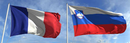 Waving flags of France and Slovenia on flagpoles, 3d rendering
