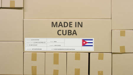 Box with printed MADE IN CUBA text and flag sticker in a warehouse