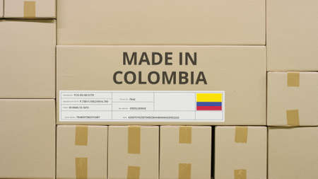 Cardboard box with printed MADE IN COLOMBIA text among other boxes