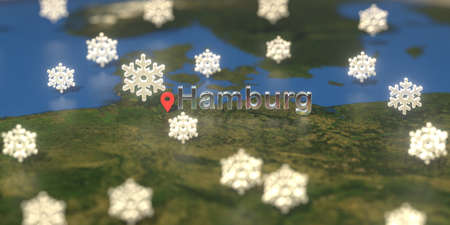 Hamburg city and snowy weather icon on the map, weather forecast related 3D rendering