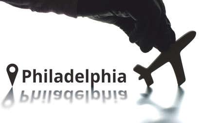 Plane icon and Philadelphia city name, air travel concept