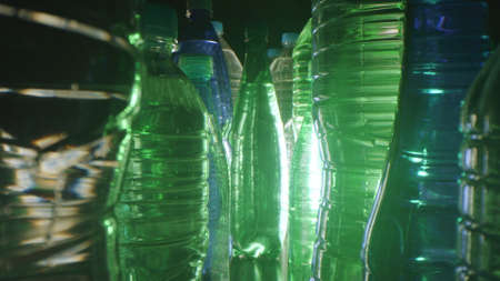 Close-up shot of many different plastic bottles with mineral water