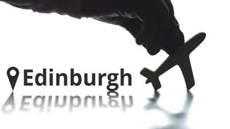 Plane icon and Edinburgh city name, air travel concept