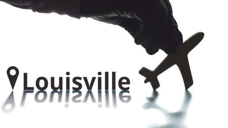 Louisville text, geotag and airplane silhouette. Travel concept
