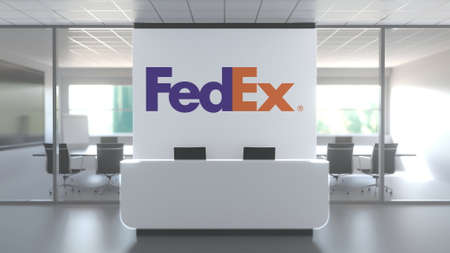 Logo of FEDEX on a wall in the modern office, editorial conceptual 3D rendering Editorial