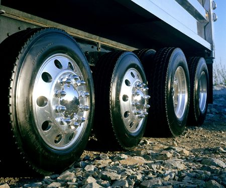 hubcap: The shiny wheels of a dump truck