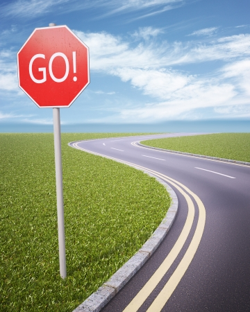 road ahead: GO! road sign Stock Photo