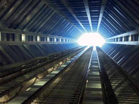 Sci-fi corridor leading to light Standard-Bild