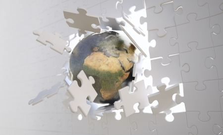 global strategy: Metallic Earth gloeb crashing through a wallbuild of jigsaw puzzle pieces