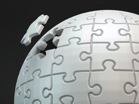 conundrum: Last piece of the puzzle. A spherical jigsaw puzzle close up shot.