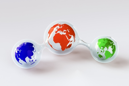 Three little globes inside a glass structure photo