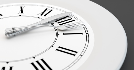 A clock like plate showing the time for a meal photo