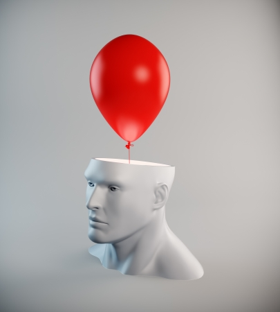 thinking balloon: A red balloon flying out of an open head - imagination concept