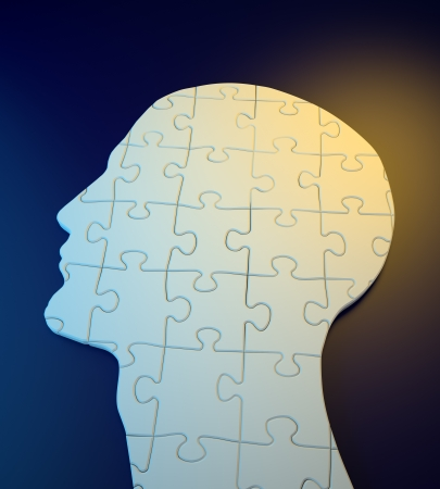 Human head build out of puzzle pieces